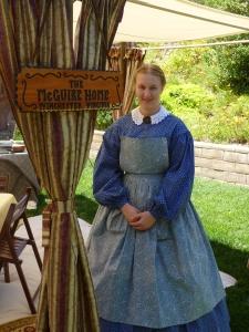 Sarah Kay Bierle portraying Miss Margaretta McGuire