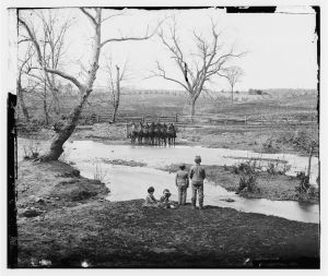 Confederate Children watching Union Cavalry near Sudley Ford (c. 1861). This photo summarizes the silent conflict between soldiers and civilians. (Public Domain).