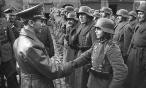 Young German Soldier receives honor Attribution: Bundesarchiv, Bild 183-J31305 / CC-BY-SA