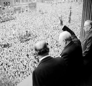Winston Churchill waving to crowds on VE Day, 1945