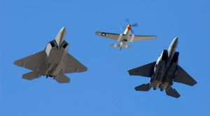 Modern Day Heritage flight with an F22 Raptor, P51 Mustang, and F15 Strike Eagle. Symbolizes the past and present of air superiority.