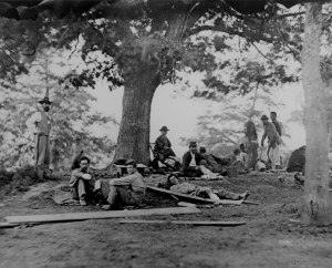 Sadie Bushman was forced to assist at a field hospital. (Note: this photo is not from Gettysburg Battlefield, but it shows wounded men waiting for assistance.