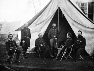 Meade and other Union commanders. (Meade is seated and is the 3rd man from the left.)