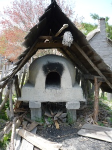 Baking bread was a woman's job. Here's a reproduction of an outdoor bake oven (Plimoth Plantation Living History Village)