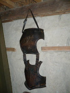 Reproduction armor (breastplate and backpiece) hanging on the wall of a house in Plimoth Plantation Living History Center