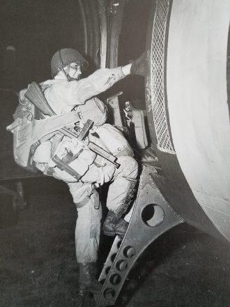 Paratrooper boarding a plane