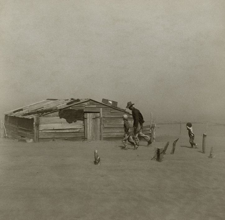 Dust Bowl scene - farmer and his sons racing for shelter as another storm descends