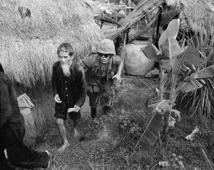 A U.S. Marine moves a captured Vietcong suspect. Friend or foe?